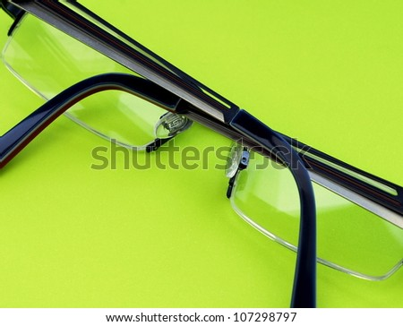 Spectacles on a green background