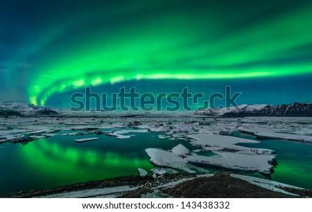 Spectacular Auroral Display Over The Glacier Lagoon Jokulsarlon In Iceland.