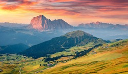 Spectacular autumn view of Sassolungo (Langkofel) and Sella group, National Park Dolomites, South Tyrol, Italy, Europe. Superb morning scene of Gardena valley, Dolomiti Alps.