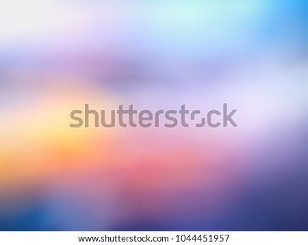 Spectacular blurred terracotta yellow clouds in purple blue sunrise sky #1044451957