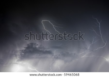 Spectacular display of lightning striking through a rain storm during a Florida summer night