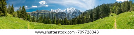 Spectacular mountain views and hiking trail in the Swiss Alps landscape near Stechelberg the district of Lauterbrunnen, Switzerland #709728043