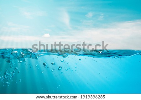 Spectacular ocean waves stop steaming with separate bubbles on a bright sky background. Popular corners, natural concepts