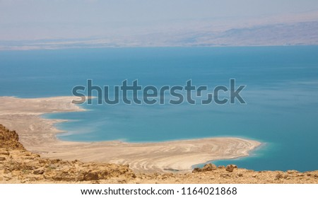 Spectacular panoramic view of the Dead Sea shore and water, Curved lines of land and water created by erosion, Dead Sea, Northern Basin,  Israel  #1164021868