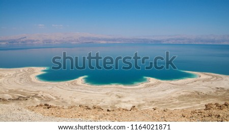 Spectacular panoramic view of the Dead Sea shore and water, Curved lines of land and water created by erosion, Dead Sea, Northern Basin,  Israel #1164021871