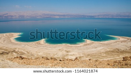 Spectacular panoramic view of the Dead Sea shore and water, Curved lines of land and water created by erosion, Dead Sea, Northern Basin,  Israel #1164021874
