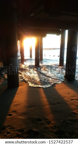 spectacular photo of sunset under pier in santa monica #1527422537