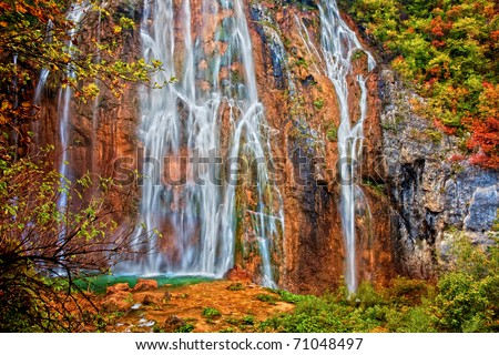 Spectacular picturesque waterfall in autumn landscape of Plitvice Lakes National Park in Croatia