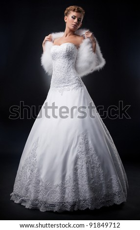 Spectacular pretty bride blonde in nuptial white dress. Formal party