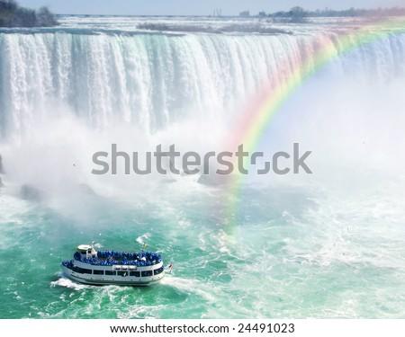 Spectacular rainbow near tourist boat at Niagara Falls