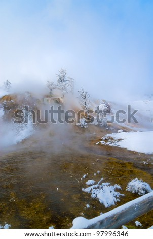 Spectacular shot of Yellowstone Mammoth geyser in winter