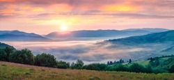Spectacular summer sunrise in Carpathian mountains. Foggy morning panorama of green mountain valley, Transcarpathian, Rika village location, Ukraine, Europe. Beauty of nature concept background.
