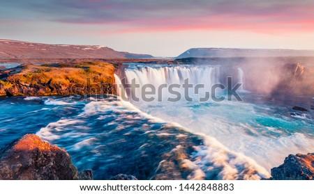 Spectacular sunrise on Skjalfandafljot river, Iceland, Europe. Magnificent summer view of Godafoss waterfall. Travel to Iceland. #1442848883