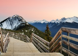 Spectacular sunset Canadian rocky mountains and boardwalk on Sulphur Mountain connect to Gondola landing in Banff, Canada. Gondola ride to Sulphur Moutain overlooks Bow Valley and the town of Banf
