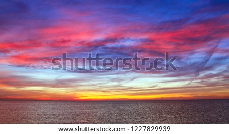 Spectacular sunset in Makkum, province Friesland in the Netherlands #1227829939