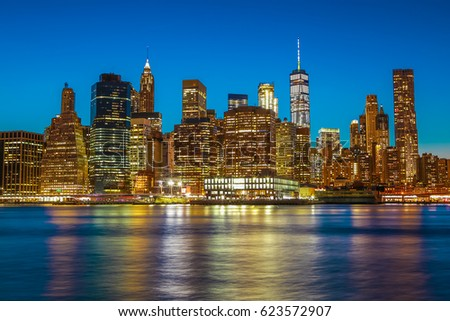 Spectacular sunset view of lower Manhattan skyline from Brooklyn Bridge Park. #623572907