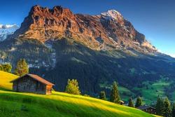 Spectacular Swiss alpine landscape with green fields and famous Eiger peak,Bernese Oberland,Switzerland,Europe