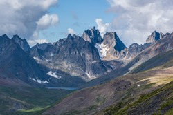 Spectacular Tombstone Territorial Park located in Northern Canada, Yukon Territory during the summertime featuring Grizzly Lake.