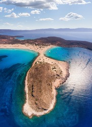 Spectacular view from the drone of Ormos Sarakiniko and Ormos Frangos on the southern coast of the Greek island of Elafonisos near the Peloponnese in the Ionian Sea