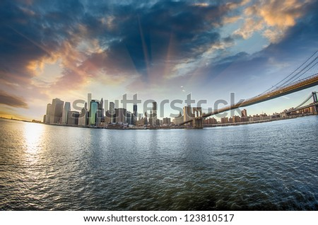 Spectacular view of Brooklyn Bridge from Brooklyn shore at winter sunset - New York City