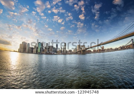 Spectacular view of Brooklyn Bridge from Brooklyn shore at winter sunset - New York City #123945748