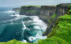 Spectacular view of famous Cliffs of Moher and wild Atlantic Ocean, County Clare, Ireland.