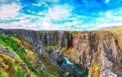 Spectacular view of  Kolugljufur canyon and Kolufossar falls. Kolugljufur gorge is located on river Vididalsa.  Location: Kolufossar waterfall, Vestur-Hunavatnssysla, Iceland, Europe