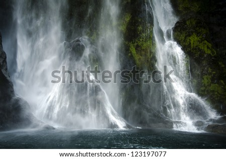 Spectacular waterfall in Milford Sound, New Zealand.