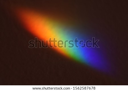 spectral colors in a light beam on a dark background  Stockfoto ©