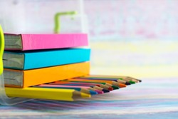 Spectrum of color pencils with soft focus background, space for caption or text. School and office concept