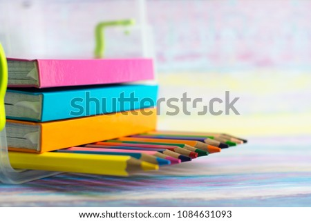 Photo of Spectrum of color pencils with soft focus background, space for caption or text. School and office concept