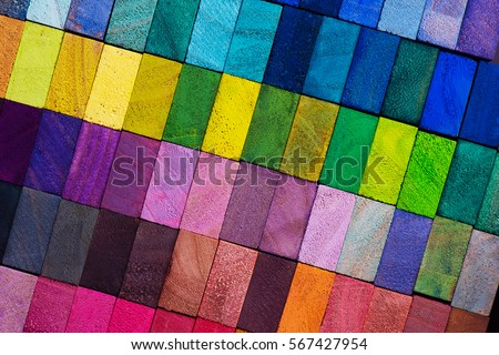Spectrum of multi colored wooden blocks aligned. Background or cover for something creative or diverse.  #567427954
