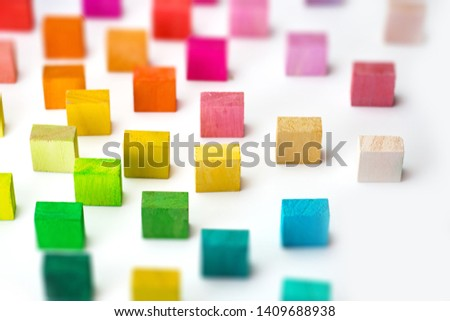 Spectrum of multi colored wooden blocks standing, on white background.  Background image or cover for something creative or diverse. #1409688938
