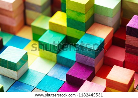 Spectrum of stacked multi-colored wooden blocks. Background or cover for something creative, diverse, expanding,  rising or growing. Stockfoto ©