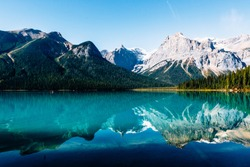 Specular reflection of mountains on Emerald lake