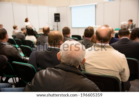 Speech at the conference hall. People at conference hall, rear view