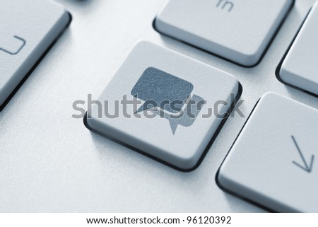 Speech bubble key button on the keyboard. Toned Image.