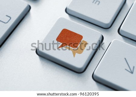 Speech bubble key button on the keyboard. Toned Image. - stock photo