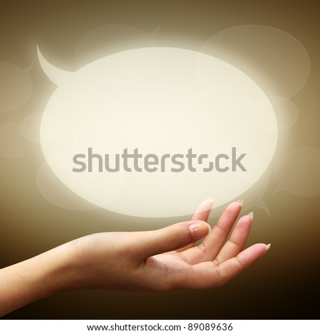 speech bubbles on woman hand on brown background
