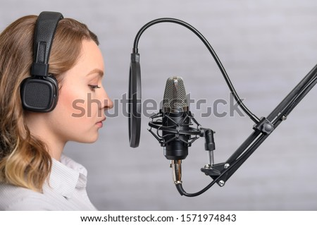 Speech recording on radio stations, the announcer works in the studio with a studio microphone