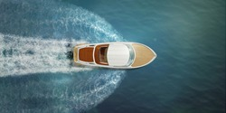 Speed boat at sea, view from above