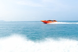 speed boat on the sea and wave