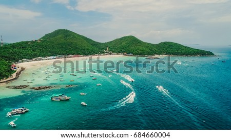Speed boats driving tourists to Tawaen beach.Koh Larn island and his tropical beaches. Beautiful landscape of Thailand sea and boats.Crystal clear water. Pattaya city,Thailand.
