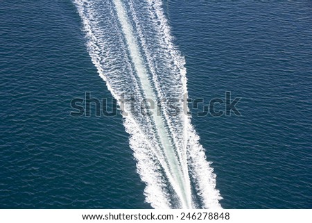 Speed boats trace on the blue sea