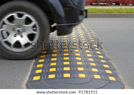 Speed bump on a road when and car