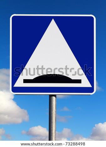 Speed bump (sleeping policeman) traffic sign on a sky background