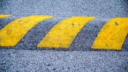Speed bumps in a Road are the common name for a family of traffic calming devices that use vertical deflection to slow motor-vehicle traffic in order to improve safety conditions.