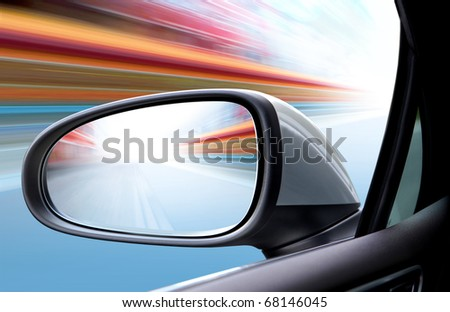 speed car driving at high speed on empty road - motion blur