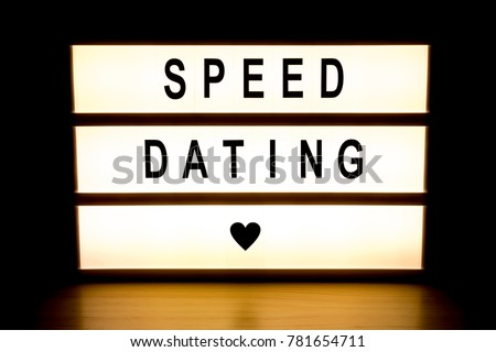 Speed dating light box sign board on wooden table.  #781654711