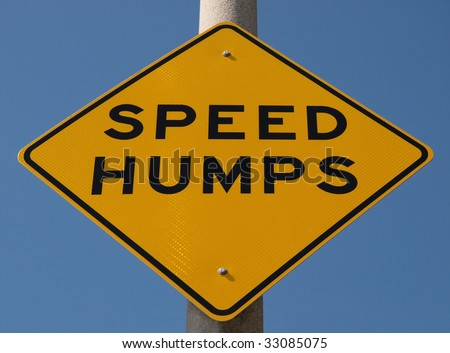Speed Humps traffic sign warning motorists of hump action ahead.